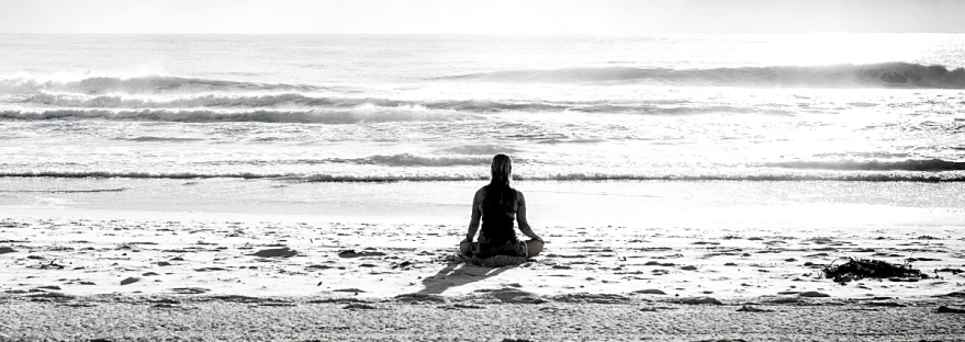 Person sitting by the sea; how to calm anxiety